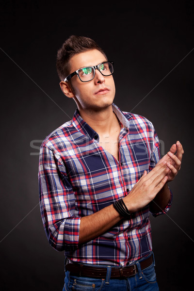 young casual man with eyeglasses clapping Stock photo © feedough