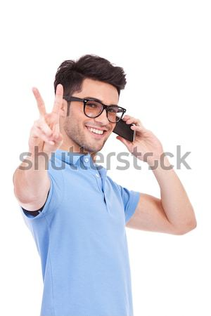 young man on the phone showing peace Stock photo © feedough
