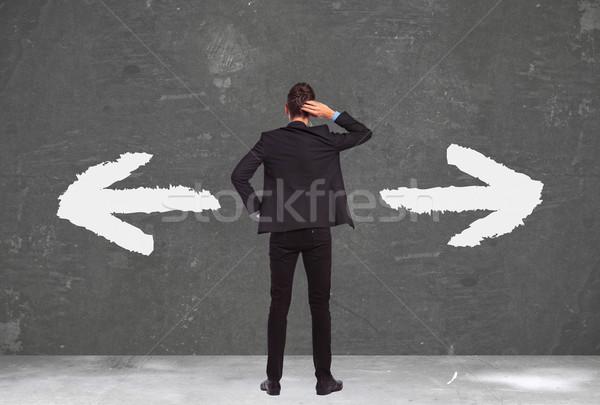 Határozatlan fiatal üzletember hát áll kéz Stock fotó © feedough