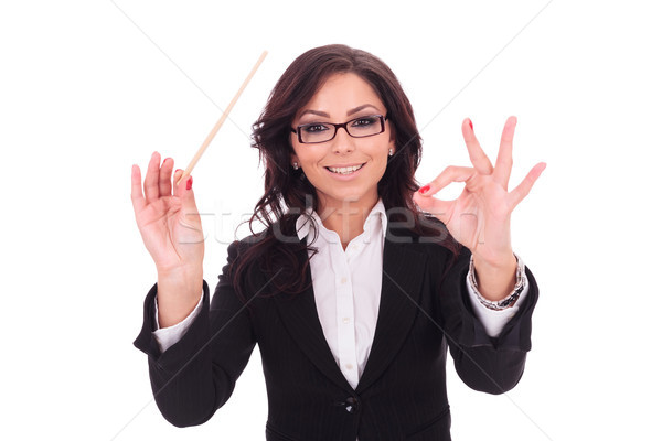 business woman conducts smilingly Stock photo © feedough