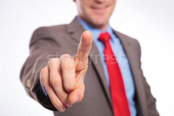 Jeunes homme d'affaires poussant imaginaire bouton souriant Photo stock © feedough