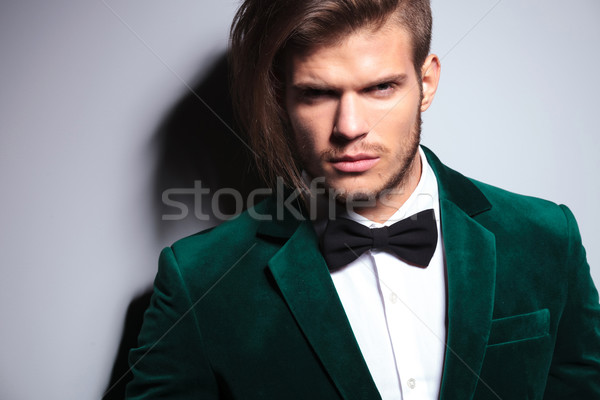 man with long hair wearing an elegant green suit and neck bow t Stock photo © feedough