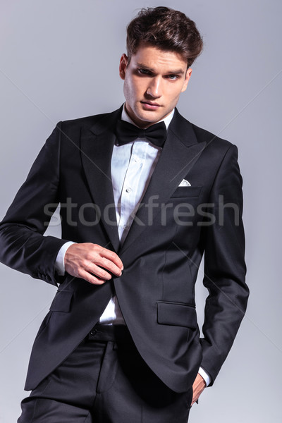 Young business man unbuttoning his jacket. Stock photo © feedough