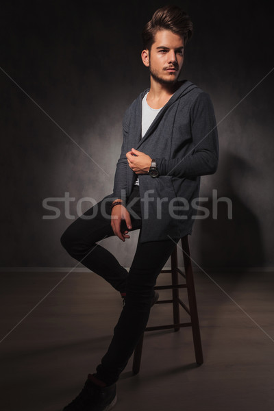 male model posing in studio while arranging his jacket Stock photo © feedough