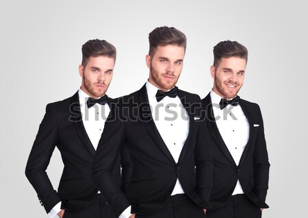 mirror reflection of relaxed young man wearing a black tuxedo Stock photo © feedough