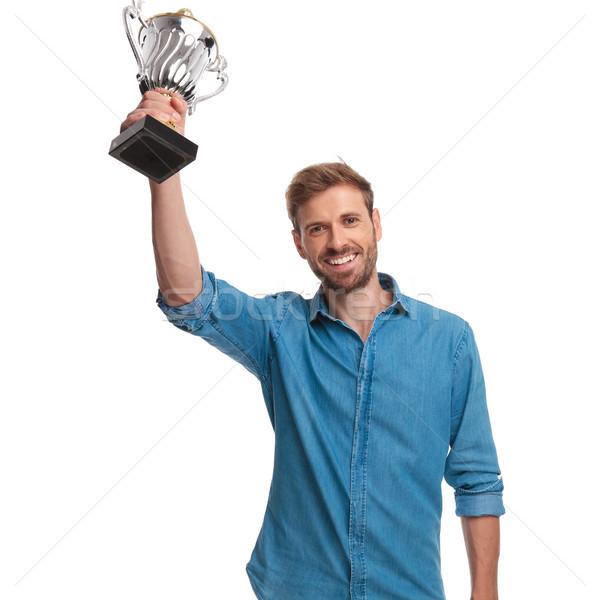 Izgatott fiatal lezser férfi tart trófea Stock fotó © feedough