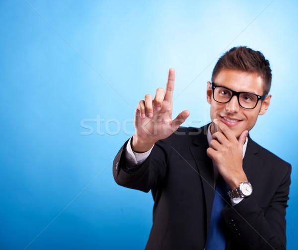 Homme poussant imaginaire numérique boutons jeunes Photo stock © feedough