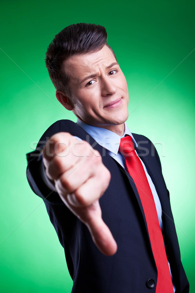 business man with thumbs down Stock photo © feedough