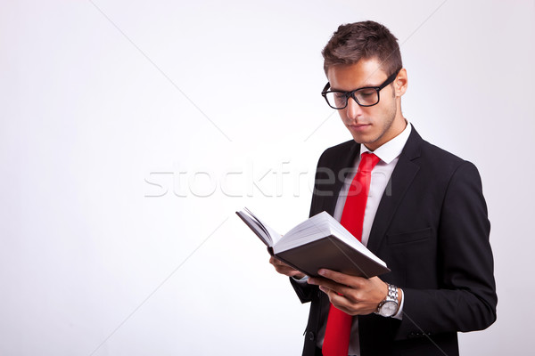 Stock photo: student wearing glasses and reading a law book