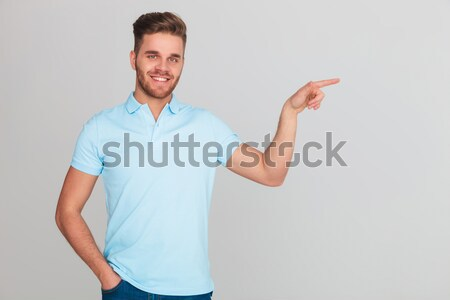 smiling casual man inviting  Stock photo © feedough