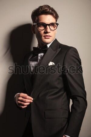 Handsome elegant business man looking down Stock photo © feedough
