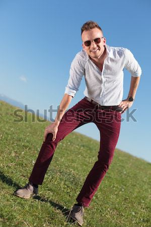 handsome young man standing with his legs apart Stock photo © feedough