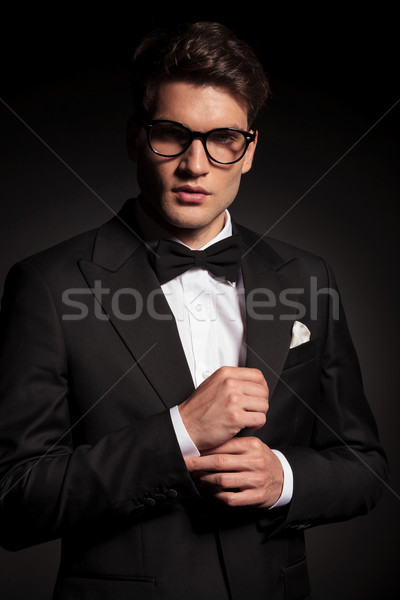 young business man fixing his sleeve. Stock photo © feedough