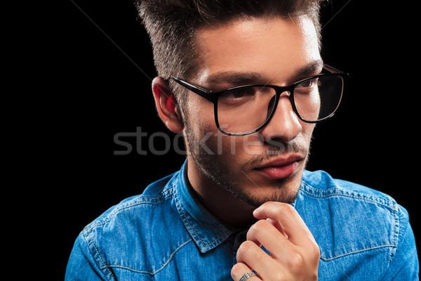 Smart jonge man denim bril denken Stockfoto © feedough