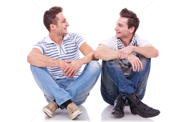 two friends smiling to each other  Stock photo © feedough