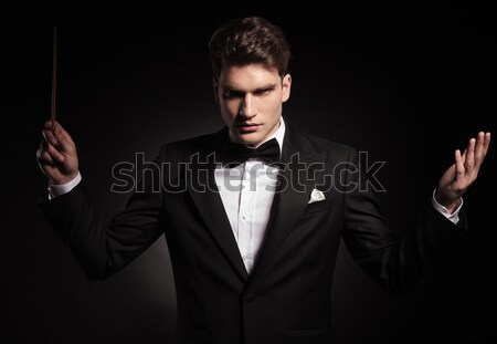 young fashion man with fingers on chin Stock photo © feedough