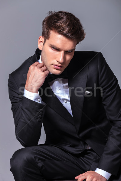 Elegant young business man looking down  Stock photo © feedough