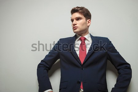 arrogant smiling business man with hands in pockets  Stock photo © feedough