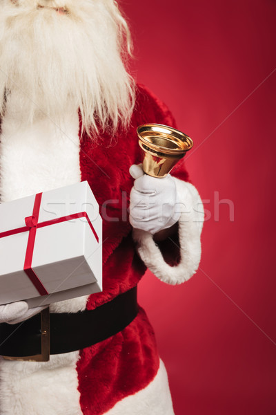 cutout image of santa claus holding present and ringing bell  Stock photo © feedough