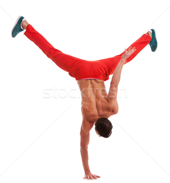 muscular dancer standing on one hand Stock photo © feedough