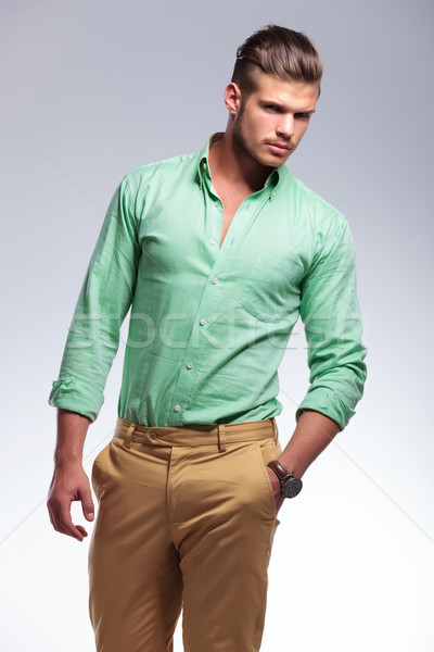 frowned casual man looks at you with hand in pocket Stock photo © feedough