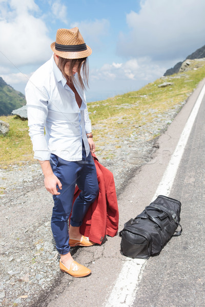 young man looks down on road side Stock photo © feedough