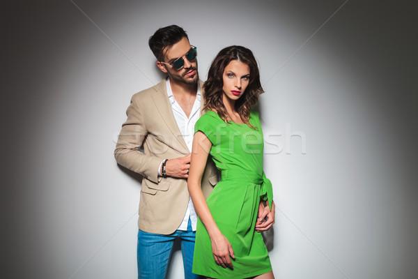 modern man behind sexy woman in green dress posing  Stock photo © feedough