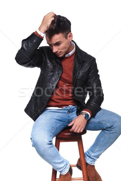 сидящий случайный человека стороны волос глядя Сток-фото © feedough