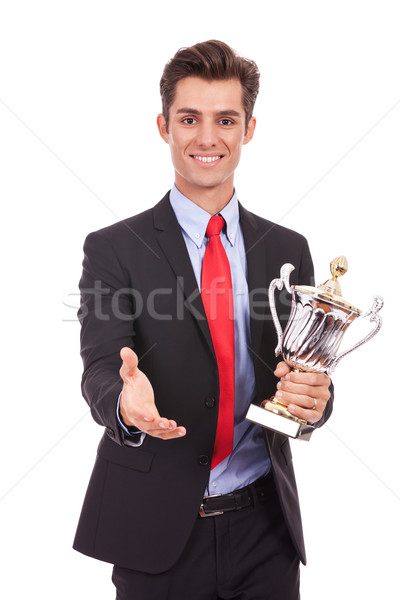 Stock photo: business man handing a trophy  and handshaking
