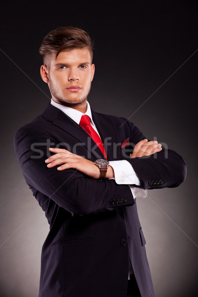 Stock photo: serious business man arms crossed
