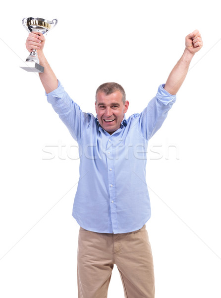 casual middle aged man cheers with trophy Stock photo © feedough