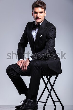 seated young man adjusting his shirt Stock photo © feedough