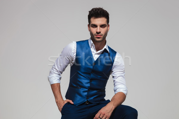 relaxed stylish man wearing a blue vest Stock photo © feedough
