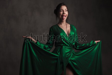 portrait of beautiful woman wearing a green gown laughing Stock photo © feedough