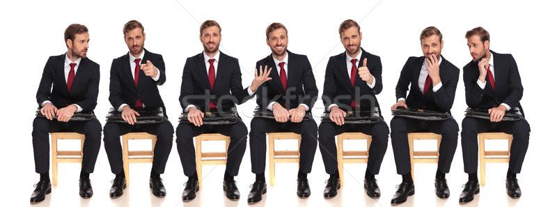 7 小さな ビジネスマン 座って スーツケース 白 ストックフォト © feedough