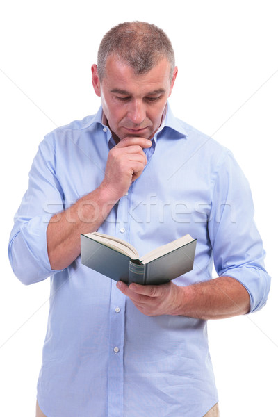 casual middle aged man reading attentive Stock photo © feedough