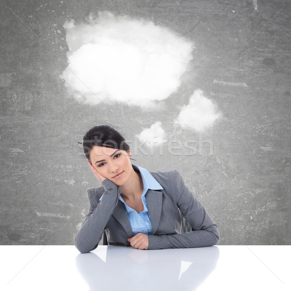 business woman at her desk with clouds as speech bubble Stock photo © feedough