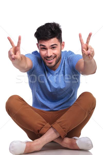 счастливым сидящий случайный человека победу Сток-фото © feedough