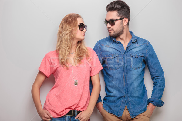 Cute young couple leaning on a wall  Stock photo © feedough