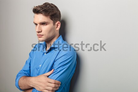 fit young casual man with hands on waist smiling Stock photo © feedough