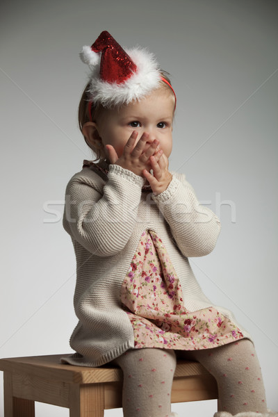 girl with palms over her mouth is expecting santa claus Stock photo © feedough