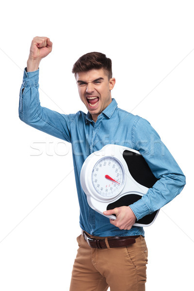 young excited man celebrating good results of dieting  Stock photo © feedough