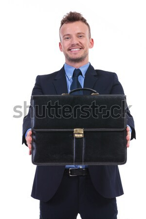 handsome businessman in navy suit holds a black briefcase Stock photo © feedough