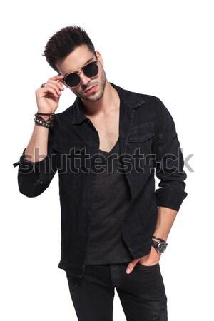 macho man in black clothes fixing his sunglasses Stock photo © feedough