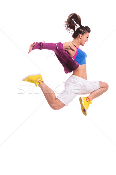 Hip hop nő táncos ugrik oldalnézet fiatal nő Stock fotó © feedough