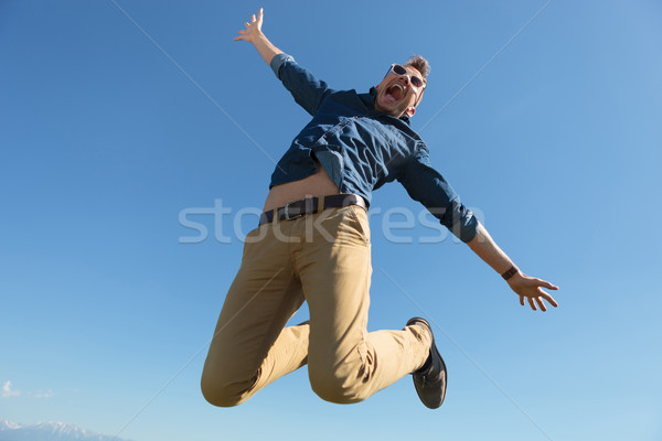 casual man jumps in mid-air Stock photo © feedough