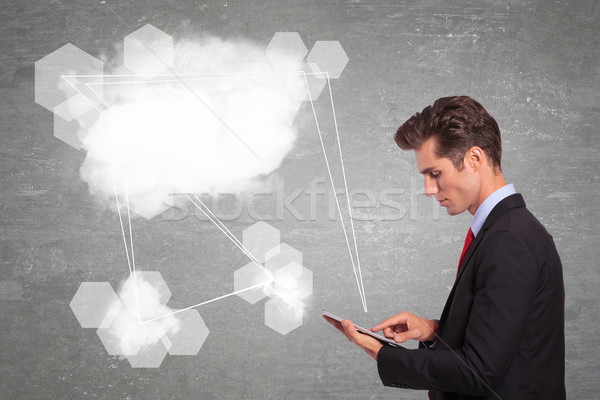 üzletember készít felhő kapcsolatok tabletta fiatal Stock fotó © feedough