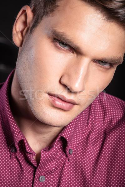 Photos jeunes homme yeux bleus Photo stock © feedough