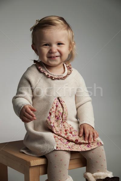 Küçük kız gülme gözyaşı oturma sandalye bebek Stok fotoğraf © feedough