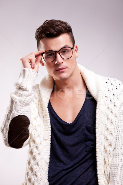 stylish young man wearing glasses Stock photo © feedough